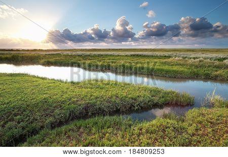 sunset over Wadde sea coast Friesland Netherlands