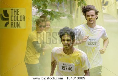 STOCKHOLM SWEDEN - MAY 22 2016: Smiling boys with yellow color dust in their face and clothes in the Color Run Event in Sweden May 22 2016