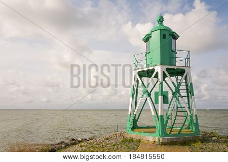 Lighthouse at the entrance of the port of Stavoren in the Netherlands