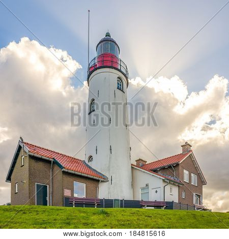 NETHERLANDS - URK - MEDIA APRIL 2017: Lighthouse in Urk at the coast of the IJsselmeer.