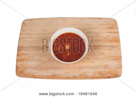Beef stew on cutting board with isolated background.