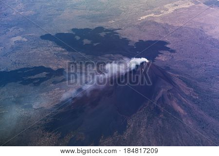 Volcano with smoke in crater aerial view. Momotombo volcano in nicaragua landscape