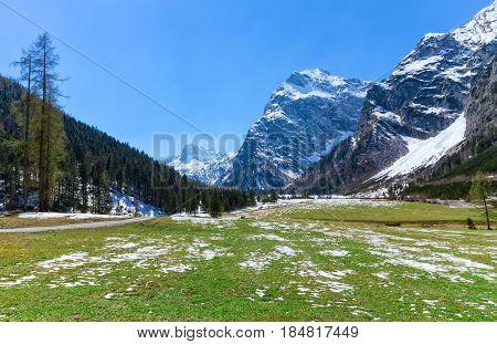 Spring mountain landscape with patches of melting snow. Austria Tyrol Karwendel Alpine Park