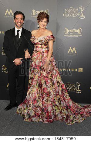 PASADENA - APR 28: JD Roberto, Carolyn Hennesy at the 44th Daytime Creative Arts Emmy Awards Gala at the Pasadena Civic Center on April 28, 2017 in Pasadena, CA
