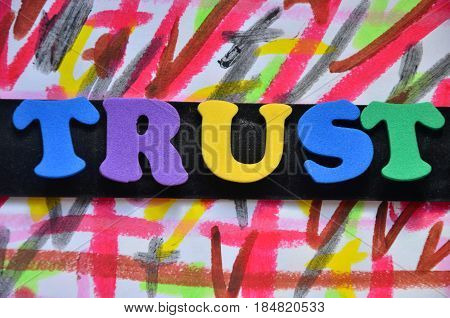 word trust on a a abstract colorful background