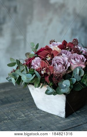 A Bouquet Of Roses In A Wooden Vase Is On The Table. Flower Arrangement In A Wooden Flowerpot