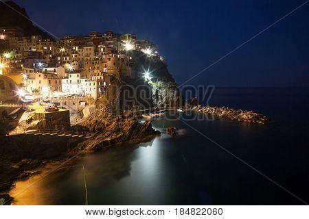 picturesque village of Manarola at night, on the Cinque Terre coast of Italy