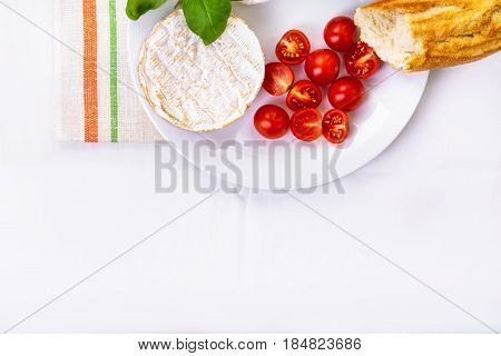 Camembert, Bread And Tomatoes On A Plate