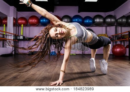 Woman Zumba fitness dancer dancing exercise on the floor in gym