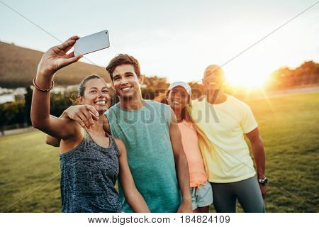 Young Sporty Woman Taking A Selfie With Friends