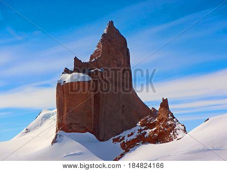 Stone rock in Antarctica on a background of blue sky and snow. Close-up. Antarctic.