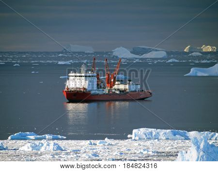 Progress station, Antarctica January 10, 2017: Cargo ship arrives in port for unloading on an ice floe. Antarctic.