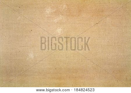 Old brown textile texture with worn spots. Abstract background