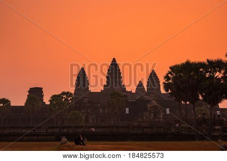 Tourists waiting for dawn at Angkor Wat temple in Cambodia. Angkor Wat is the largest Hindu temple complex and religious monument in the world