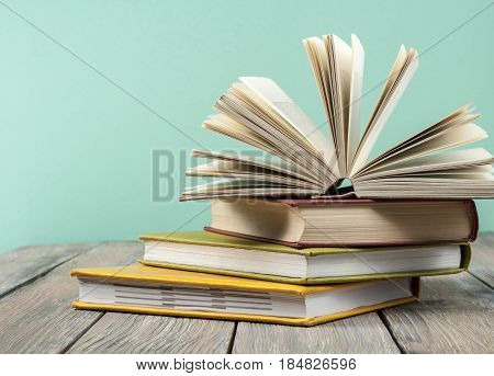 Open book, hardback books on wooden background. Back to school. Copy space for text