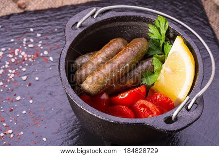 The fried sausages from beef forcemeat, are served with vegetables and greens, and with spices