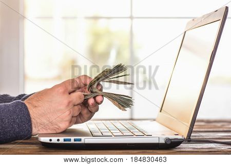 Man Counting His Cash Which He Earned On Internet, Make Money Online Concept