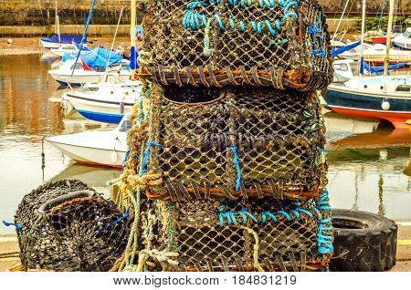 Fishing Lobster Baskets And Crabs Layered On It, Fishing Industry, Fishing Lines, Boats In The Harbo