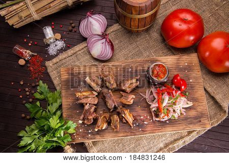 Mutton sunflower seeds with sauce ajika, is served with onions salad