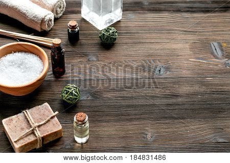 bathroom salt and natural soap for spa set on wooden background mock-up