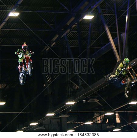 St. Petersburg Russia - 15 April, Bikers in the air under the ceiling,15 April, 2017. International Motor Show IMIS-2017 in Expoforurum. Moto show at the St. Petersburg moto salon.