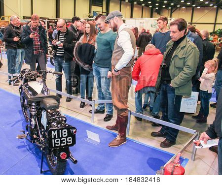 St. Petersburg Russia - 15 April, Group of visitors at a retro model,15 April, 2017. International Motor Show IMIS-2017 in Expoforurum. Visitors and participants of the annual moto-salon in St. Petersburg.