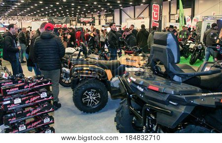 St. Petersburg Russia - 15 April, Crowd of people among motor vehicles,15 April, 2017. International Motor Show IMIS-2017 in Expoforurum. Visitors and participants of the annual moto-salon in St. Petersburg.