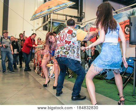 St. Petersburg Russia - 15 April, Dancing group shows,15 April, 2017. International Motor Show IMIS-2017 in Expoforurum. Erotic dances of the girls at the motor show.