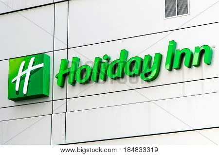 New York April 28 2017: The logo and sign on one of Holiday Inn hotels in Manhattan.