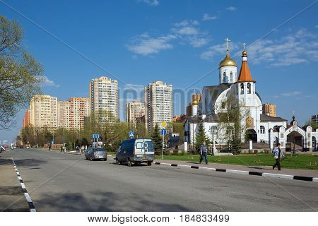 REUTOV/ RUSSIA - APRIL 30, 2017. Kazan church near the new residential buildings in city of Reutov, Moscow region, Russia.