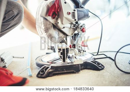 Construction Worker Cutting And Sawing Metal With Circular Grinder, Mitre-saw