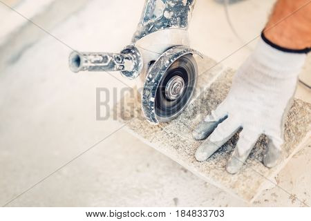 Industrial Tool, Hand Grinder Cutting Granite Stone Used For Paving .