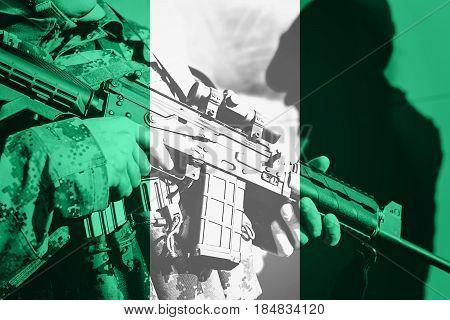 Soldier With Machine Gun With National Flag Of Nigeria