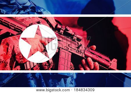 Soldier With Machine Gun With National Flag Of North Korea