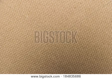 Close-up of beige fleece fabric material texture background