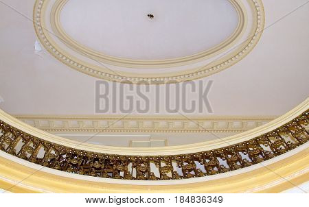 Elaborate oval gold and black design on ceiling