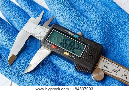 Digital caliper on working glove with rubber coating