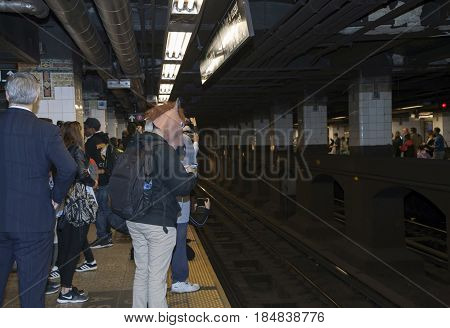 BRONX NEW YORK USA - APRIL 10: Man wearing head of horse waiting for train in Manhattan subway. Taken April 10 2017 in New York.