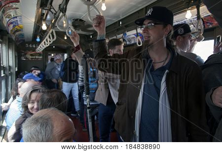 BRONX NEW YORK USA - APRIL 10 :Yankee fans ride Low Voltage vintage train to stadium for opening day game Taken April 10 2017 in New York.