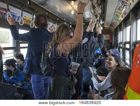 BRONX NEW YORK USA - APRIL 10: Yankee fans ride Low Voltage vintage train to stadium for opening day game. Taken April 10 2017 in New York.