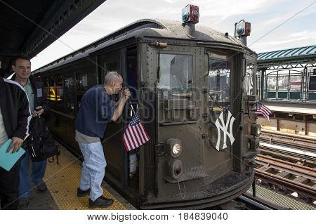 BRONX NEW YORK USA - APRIL 10: Blind man asks directions from conductor of Low Voltage vintage train at Yankee Stadium used for opening day game. Taken April 10 2017 in New York.