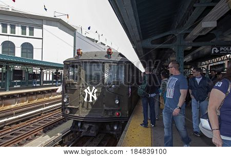 BRONX NEW YORK USA - APRIL 10: A vintage Low Voltage train from the early 1900's stops at Yankee Stadium for opening day game. Taken April 10 2017 in New York.