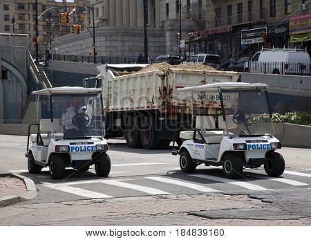 BRONX NEW YORK USA - APRIL 10: Police patrol in club cars around community streets during Yankee Stadium opening game. Taken April 10 2017 in New York.
