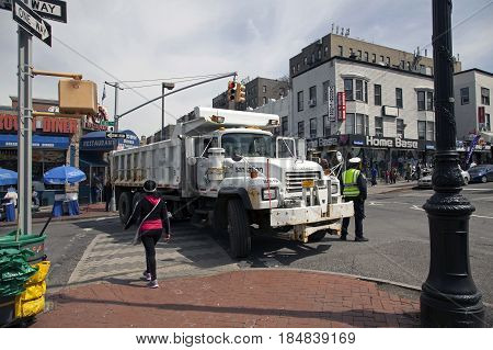 BRONX NEW YORK USA - APRIL 10: Sanitation sand truck used as barrier during Yankee Stadium opening day. Taken April 10 2017 in New York.