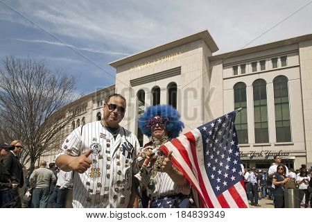 BRONX NEW YORK USA - APRIL 10: Flag holding Lenny Love and Yanee fan pose for a photo on opening day. Taken April 10 2017 in New York.