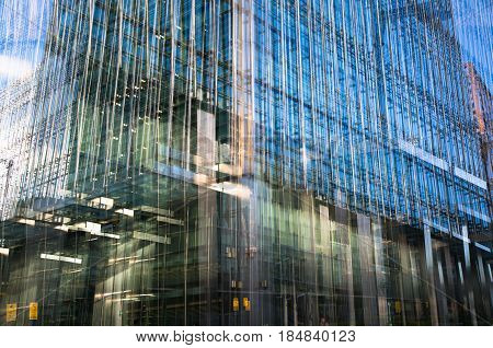 London, UK - 11 November, 2016: Multiple exposure image of office building in Canary Wharf.