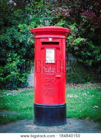 Traditional British shiney red village post box