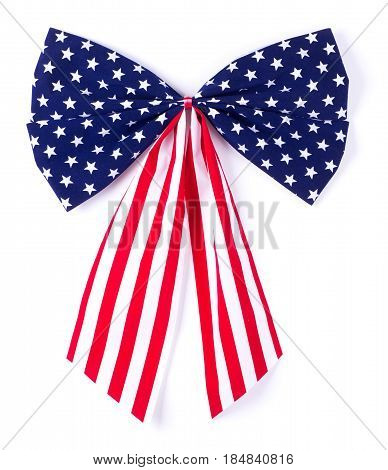 Patriotic red white and blue bow and ribbon on a white background