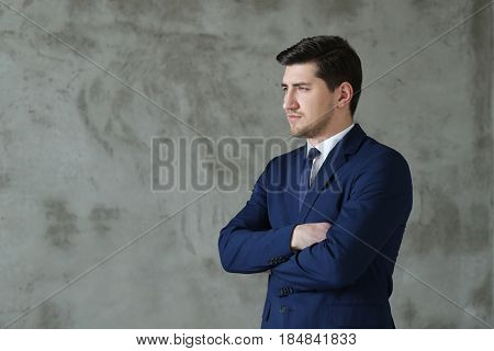 Young businessman in blue suit