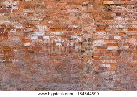 Closeup of vintage red brick wall, background texture photo of old rectangular block building material